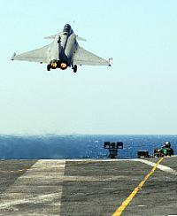 French Navy RAFALE fighter aircraft takeoff from a carrier aircraft deck