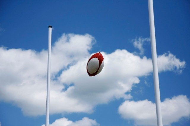 Rugby union ball between the poles